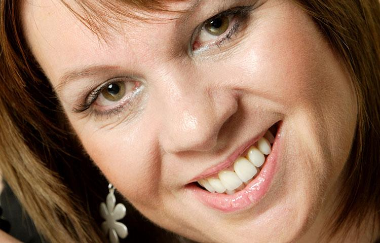 Woman smiling showing teeth for dental example